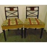 A pair of Regency mahogany dining chairs with upholstered tapestry seats on turned tubular legs
