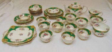 Paragon tea service to include a teapot, a milk jug, a sugar bowl, plates, cups and saucers (37)