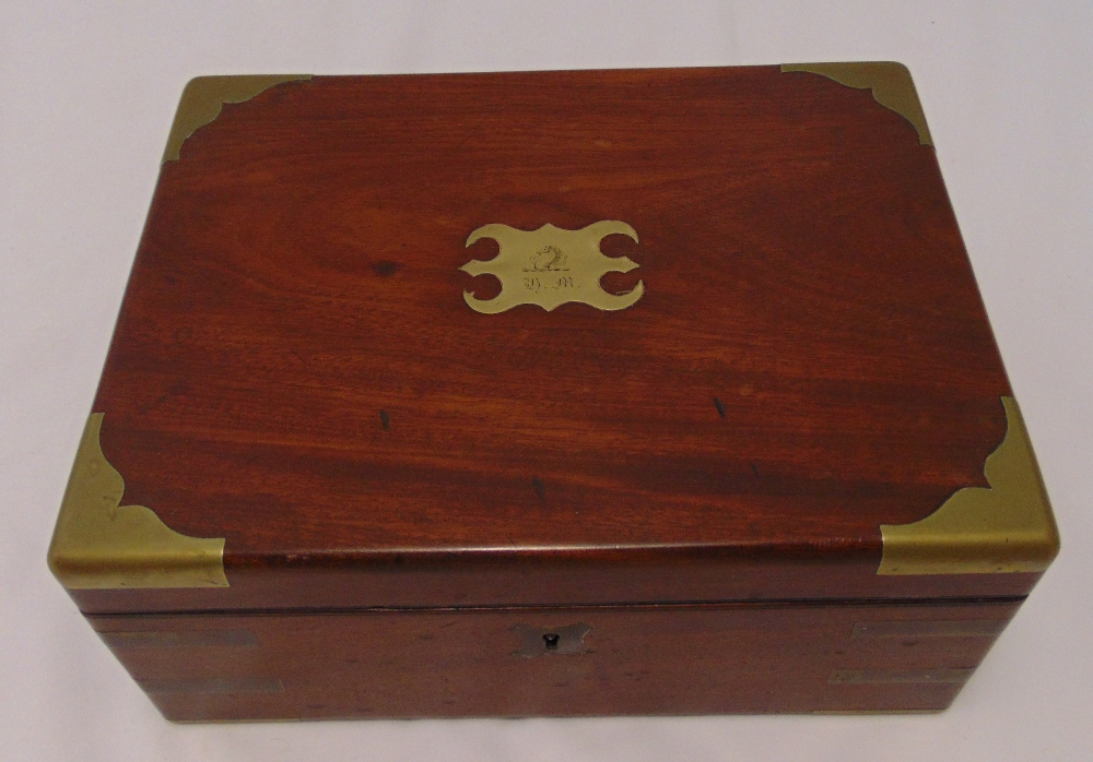 A Victorian rectangular brass bound humidor, the hinged cover revealing a quantity of cigars, 13 x
