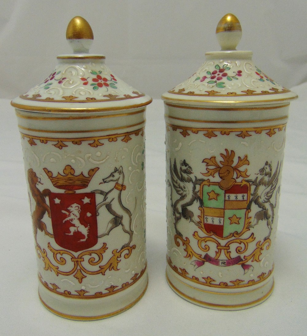 A pair of Limoges cylindrical armorial covered vases with domed pull off covers, 20cm (h)