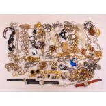 A quantity of costume jewellery to include necklaces, rings, brooches, pendants and watches