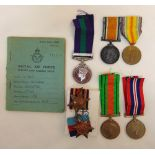 A quantity WWI and WWII medals with appropriate ribbons and a RAF log book, medals attributed to G-