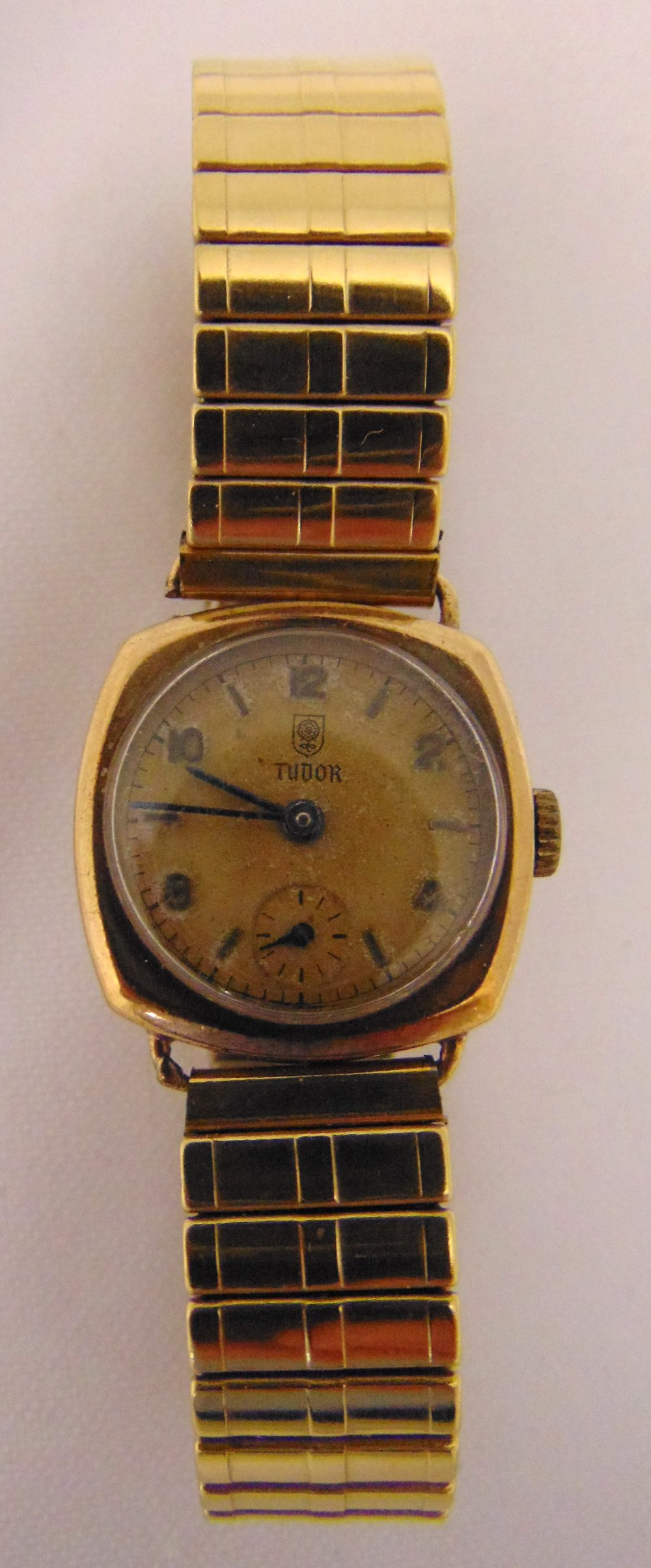 Tudor 9ct gold ladies wristwatch on a gold plated expanding bracelet