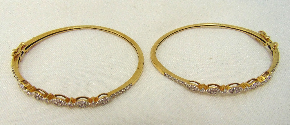 Two 9ct gold and diamond bangles, approx total weight 17.8g
