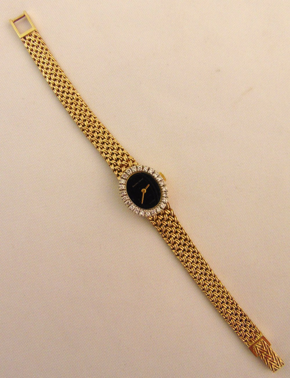 Bueche Girod 9ct gold ladies wristwatch with diamond bezel and integral 9ct gold bracelet, approx