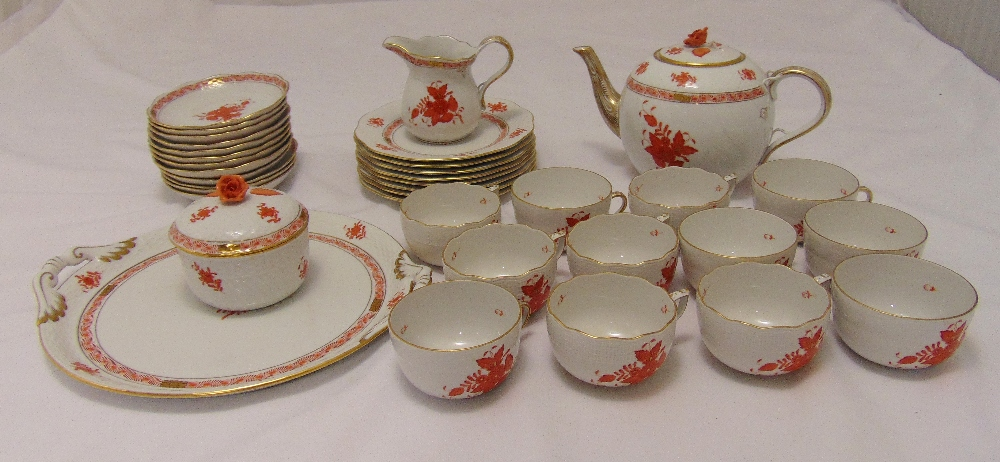 A Herend Chinese bouquet teaset to include a teapot, sugar bowl, a milk jug, cups and saucers (35)