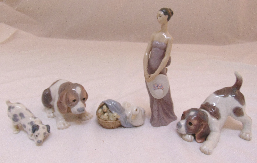 Five Lladro figurines to include dogs, a goose and a lady, tallest 21cm (h)