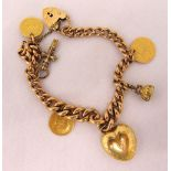 9ct gold charm bracelet with five charms and a padlock, approx total weight 35.0g