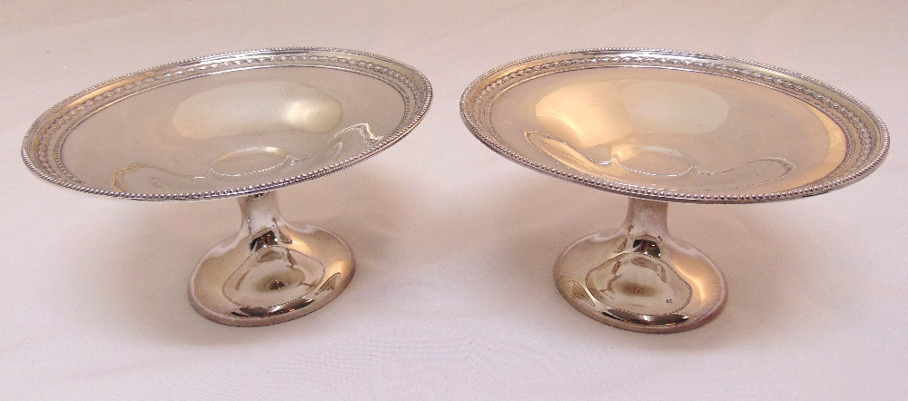 A pair of Victorian hallmarked silver fruit stands with bead and husk borders, Sheffield 1898 and