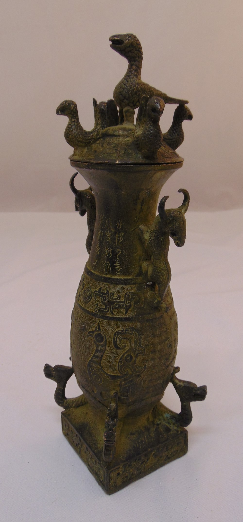 A Chinese bronze wine ewer and cover with applied casts birds and animals, 30cm (h)