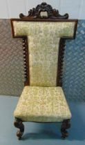 A Victorian mahogany upholstered prayer chair with barley twist column sides on four scroll legs