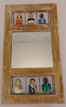 A Brazilian rectangular wooden folk art mirror with hand painted carved figurines, 79.5 x 44.5cm