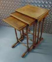 A nest of three rectangular mahogany tables with turned supports and stretchers on angled feet, 65 x