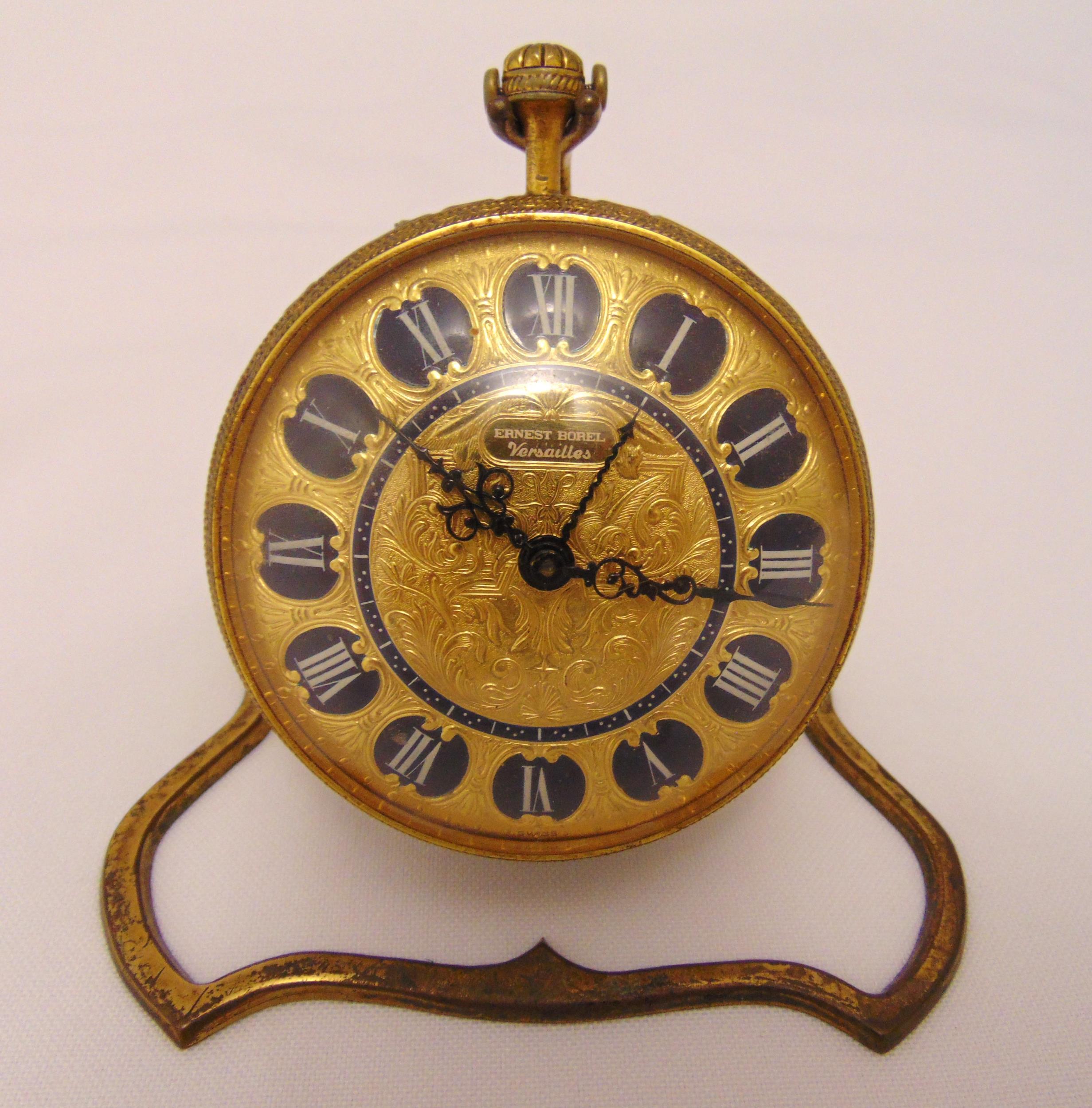 Ernest Borel Rococo revival Versailles 8 day desk clock with Roman numerals, on scrolling metal