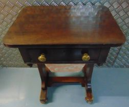 A rectangular mahogany sewing table, single drawer with brass handles on scrolling bracket supports,