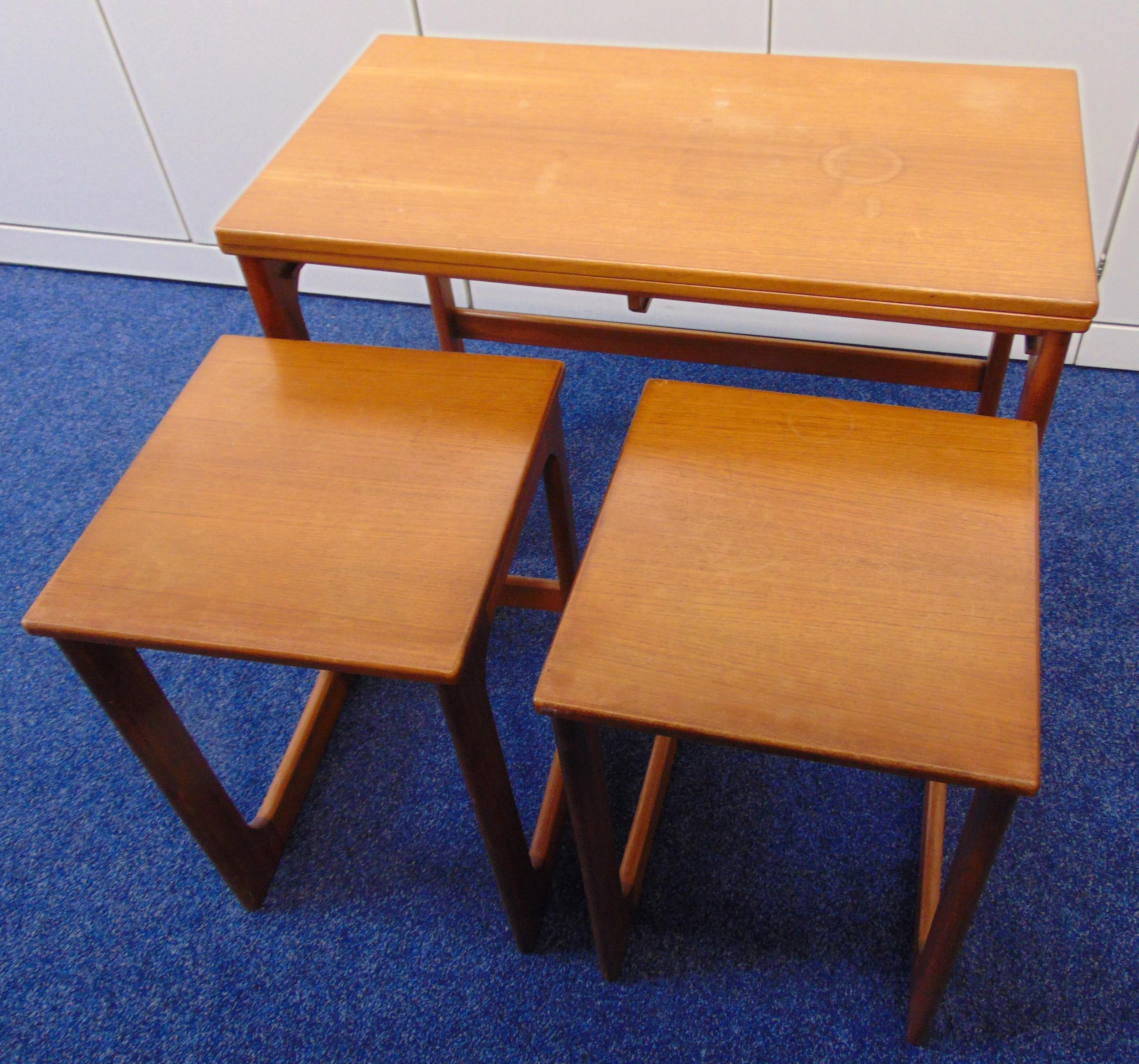 A rectangular teak tea table with revolving folding top and two matching side tables by Macintosh of - Image 2 of 4