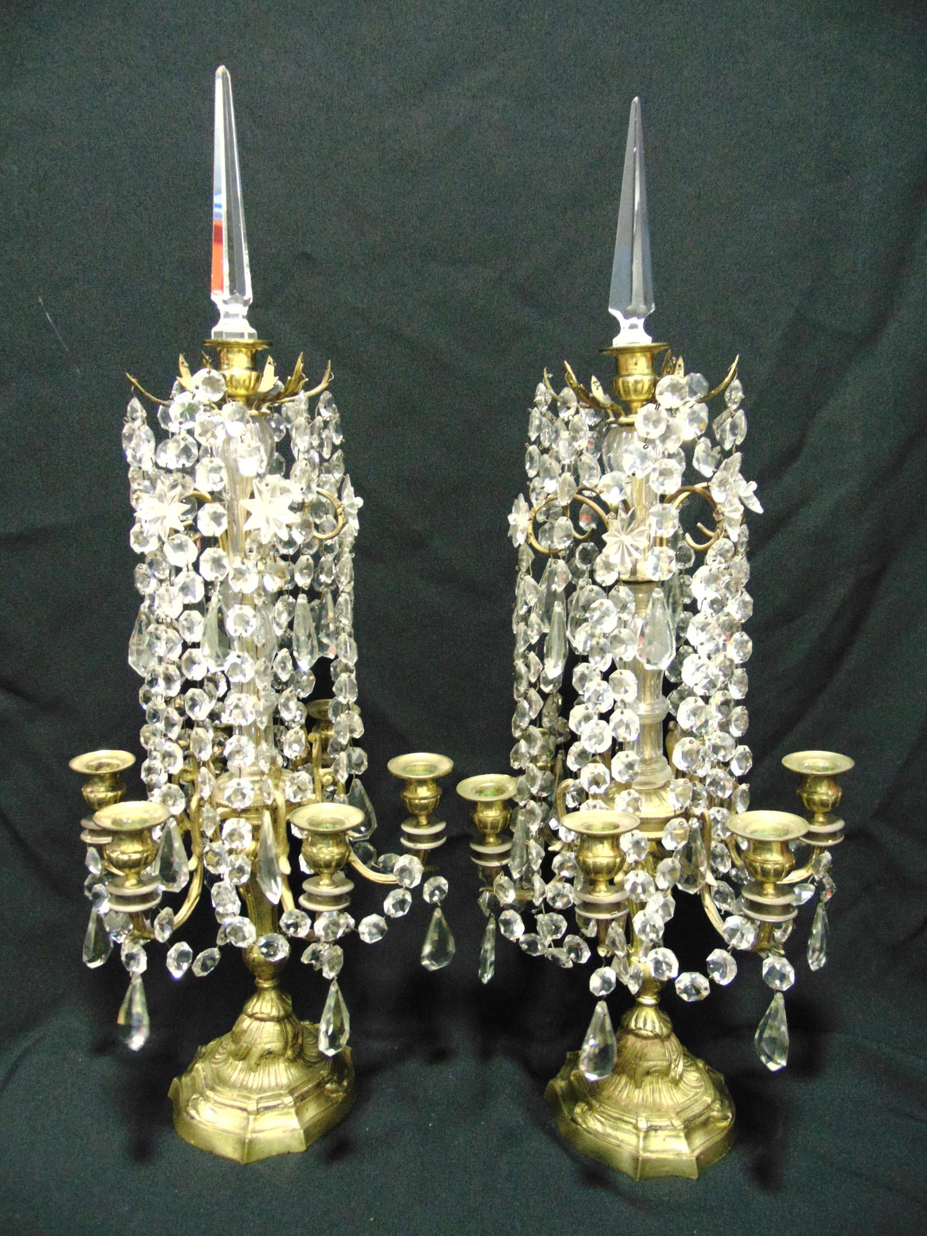 A pair of six light gilded metal and crystal Louis XV style candle girandoles, the naturalistic