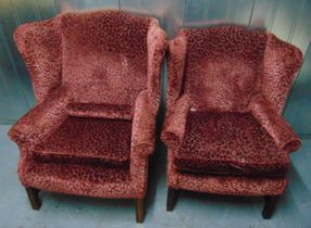 Two upholstered Mummy and Daddy wing back armchairs on four tapering rectangular legs