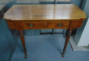 A late 19th century shaped rectangular mahogany desk, the single drawer with two brass swing