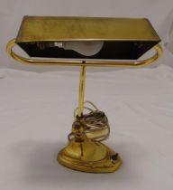 An early 20th century rectangular brass desk lamp on raised shaped oval base, 39cm (h)