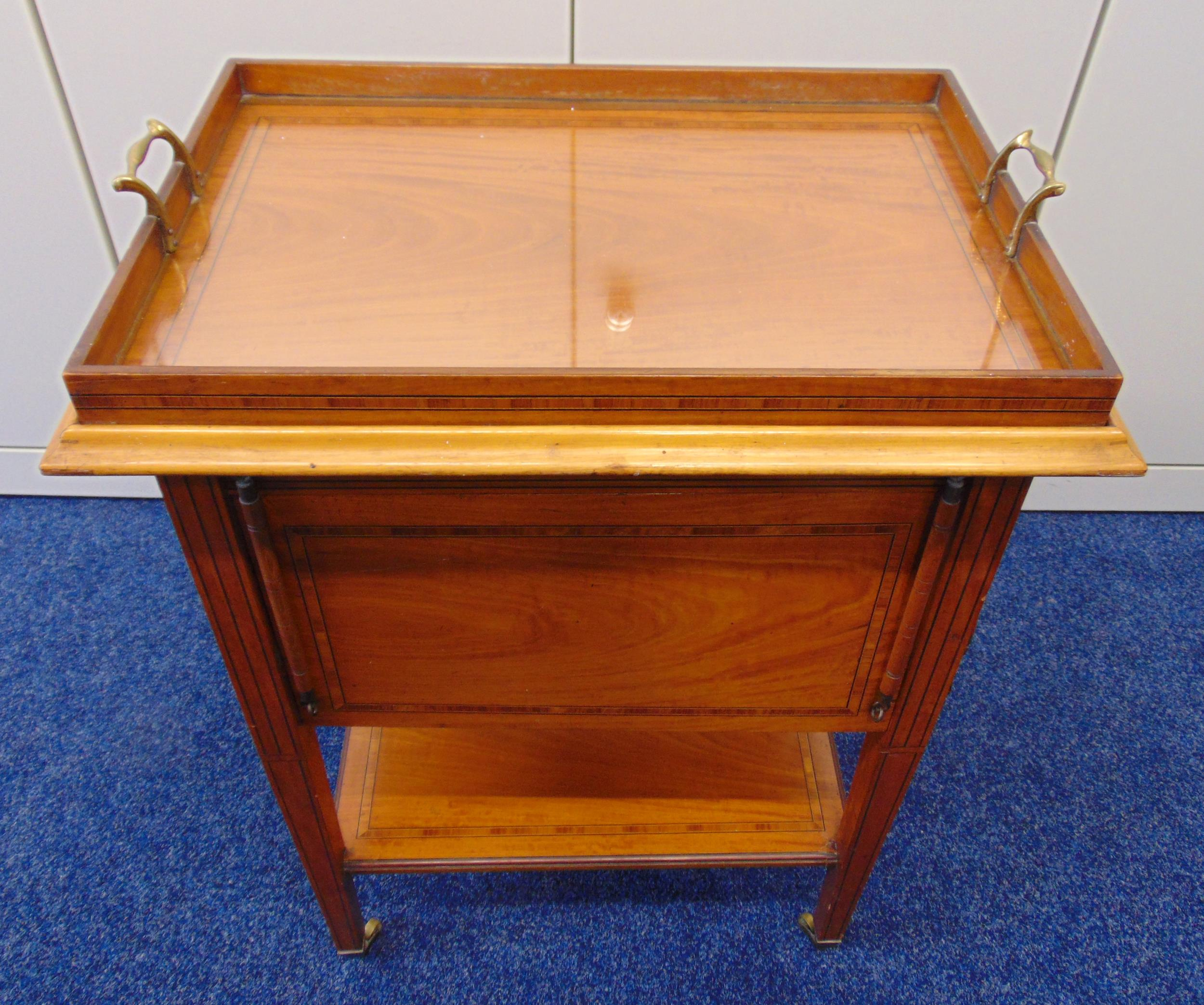A rectangular French mahogany tea tray table with satinwood inlaid bands and hinged sides, on four - Image 2 of 2