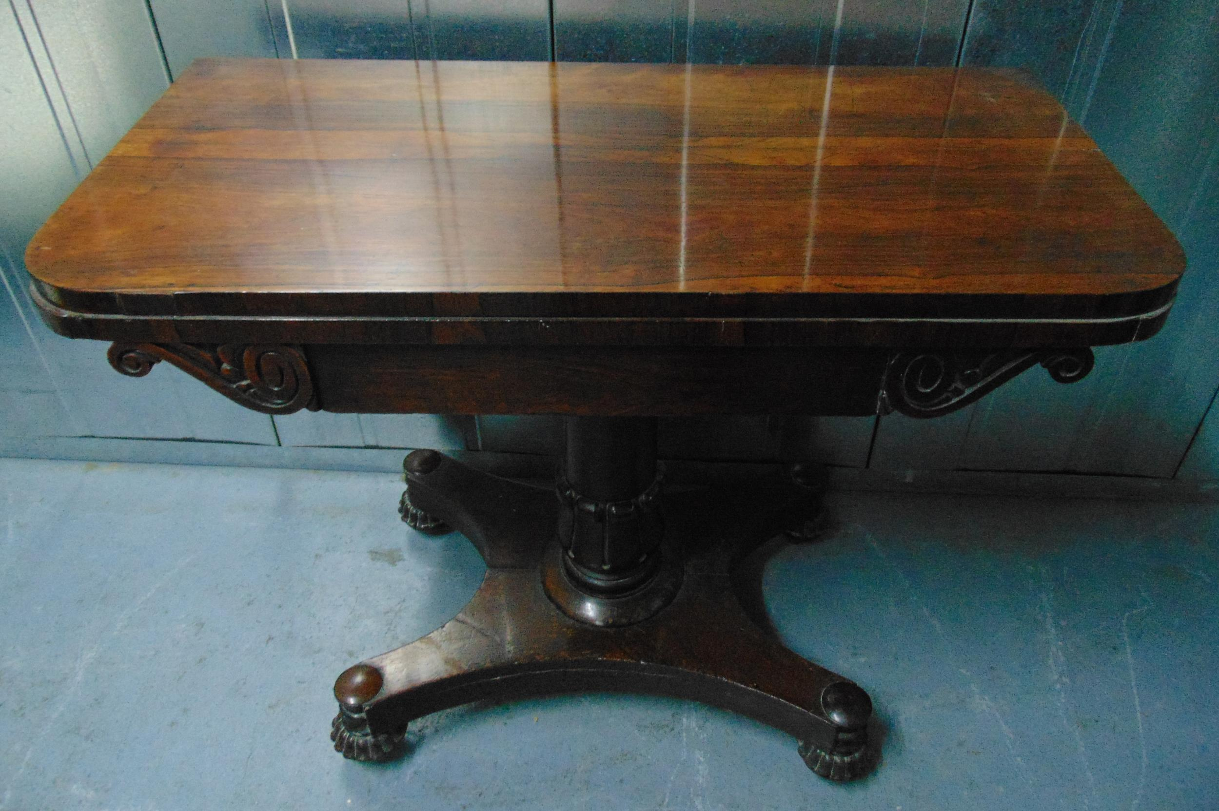 A Victorian rectangular mahogany games table, the hinged top on column support and shaped square