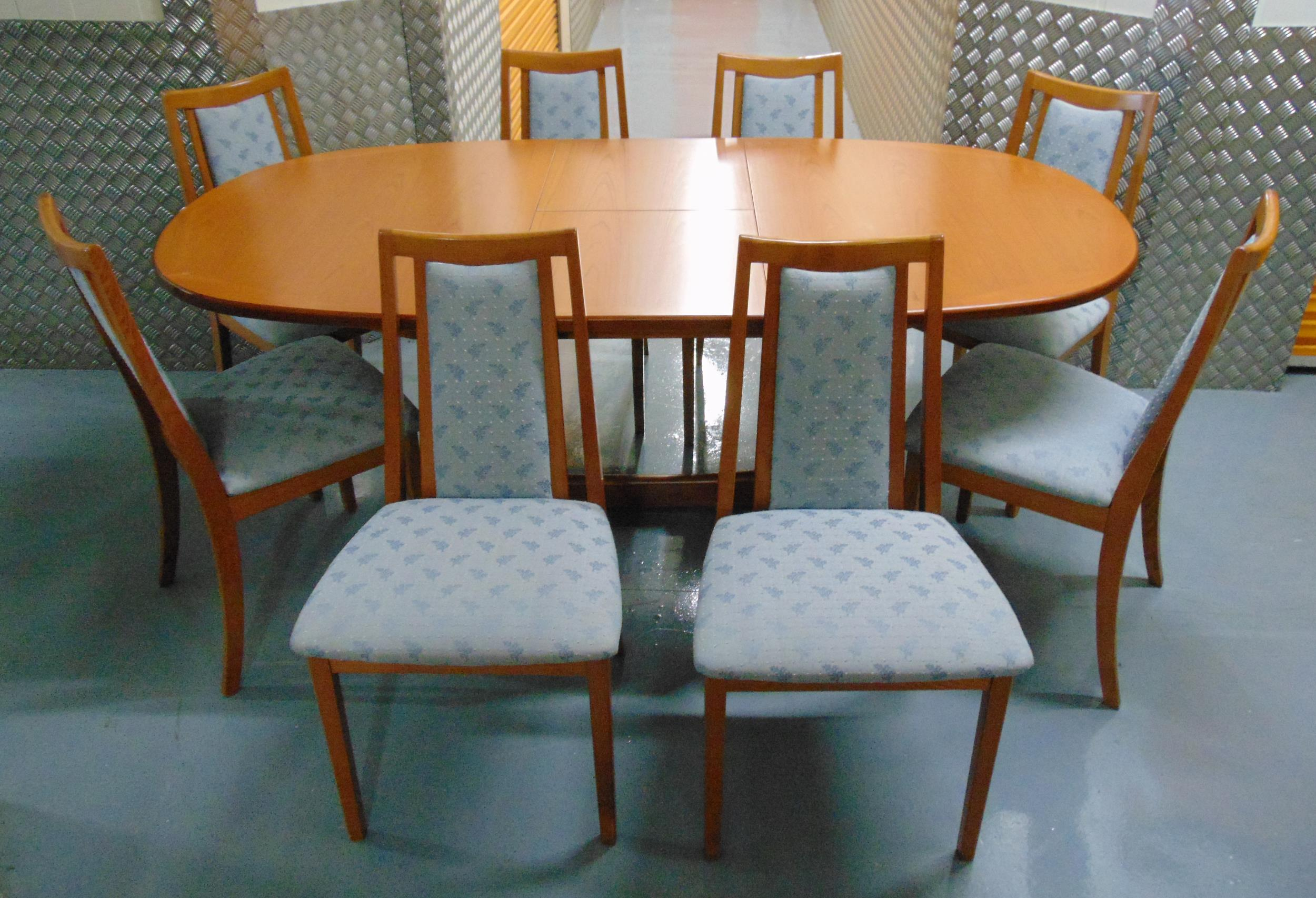 G-Plan extending oval teak dining table circa 1970 and eight matching dining chairs with upholstered