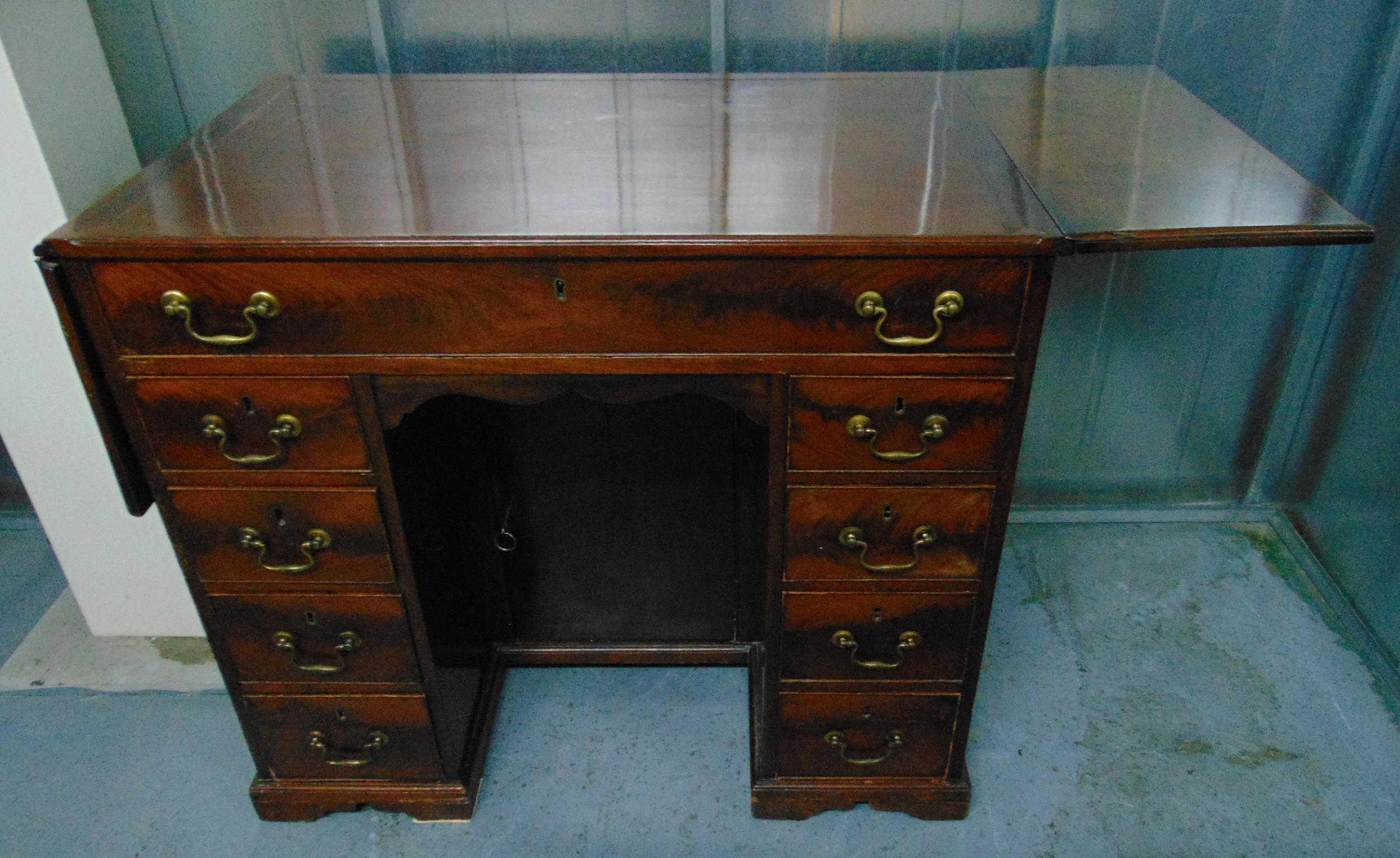 A rectangular mahogany kneehole desk with drop flap to the sides, nine drawers with brass swing - Image 2 of 2