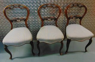 Three Queen Anne style mahogany dining chairs, scroll and pierced carved backs on cabriole legs