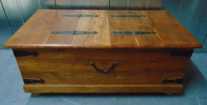 A rectangular wooden chest with metal bands to the sides and hinged top, 46 x 110.5 x 60cm