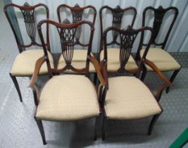 A set of six Edwardian dining chairs, two carvers, carved and pierced backs on tapering