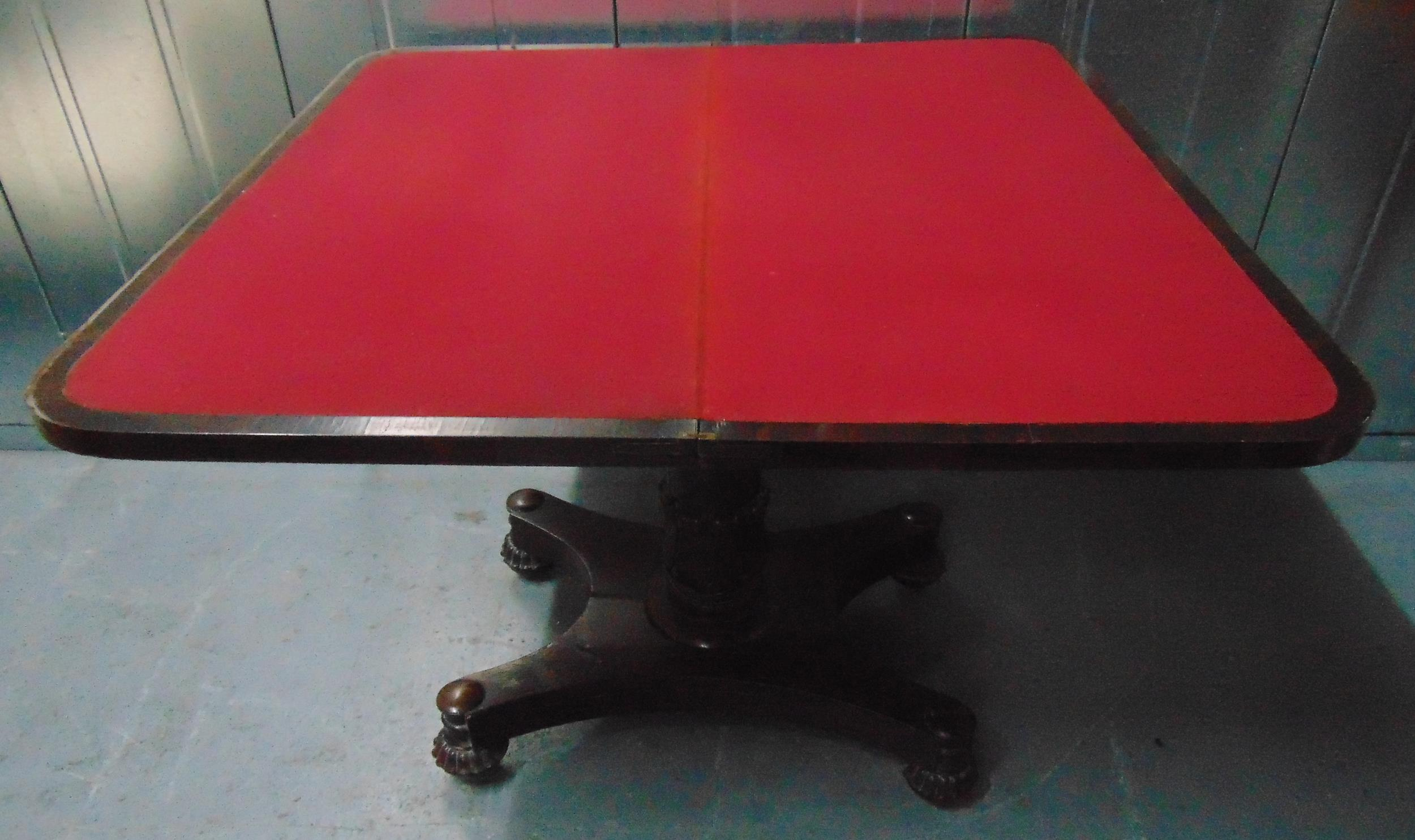 A Victorian rectangular mahogany games table, the hinged top on column support and shaped square - Image 2 of 2