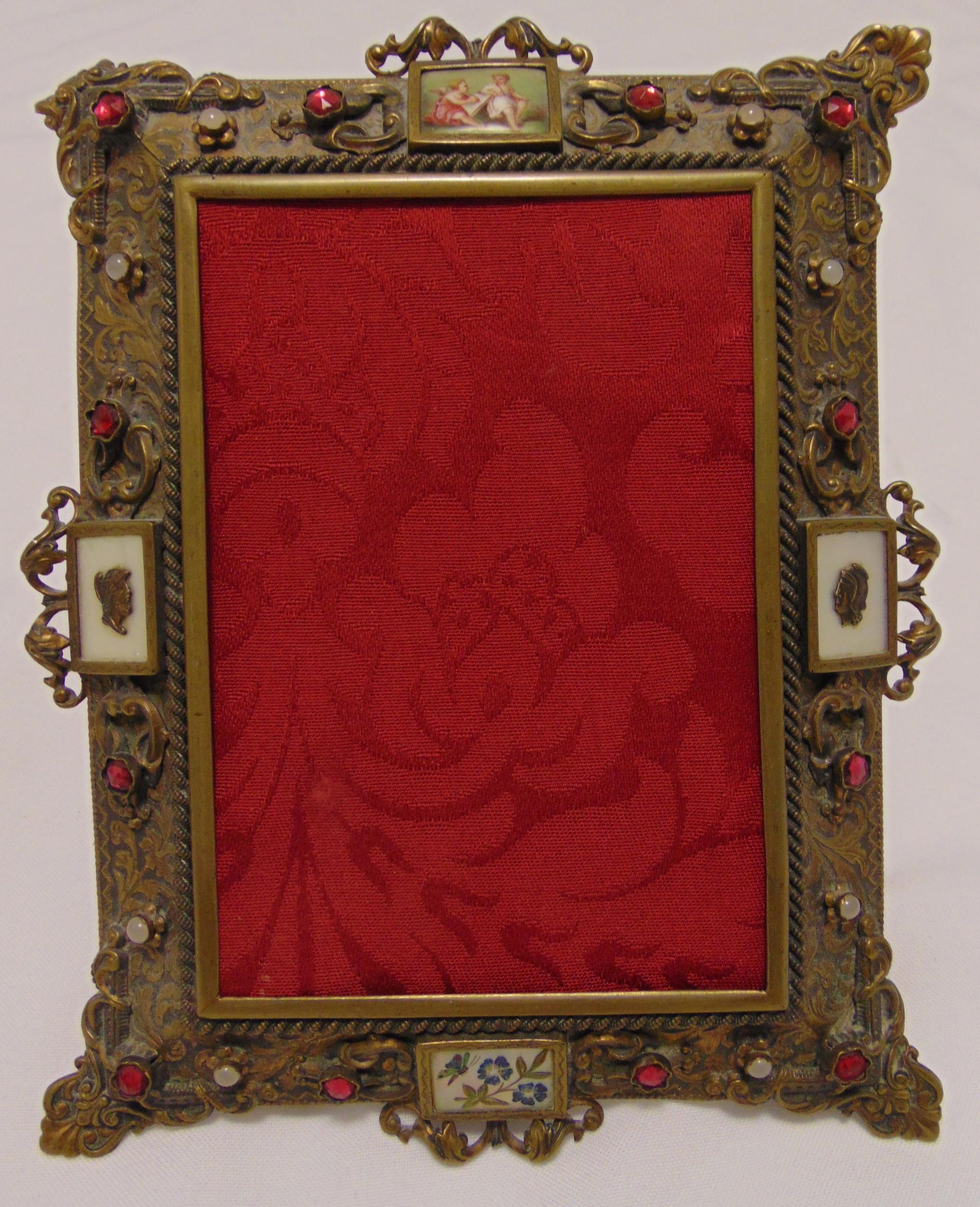 A 19th century French rectangular photograph frame decorated with jewels and vignettes, 19 x 15cm