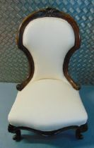 A Victorian ladies mahogany nursery chair with upholstered seat and back on four scroll legs