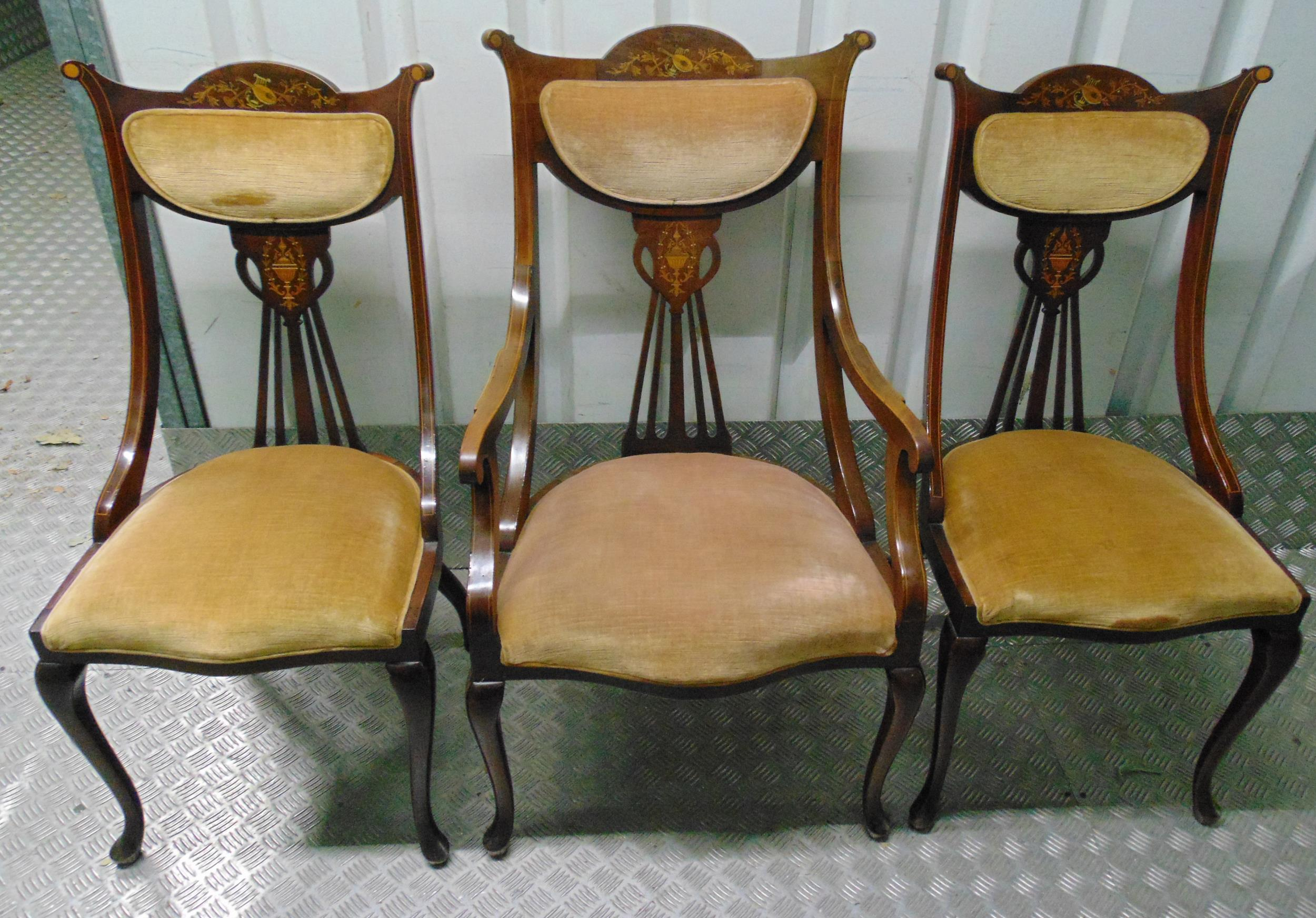 A suite of three Edwardian mahogany occasional chairs with satinwood inlays and upholstered seats