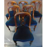 A set of six Victorian mahogany upholstered dining chairs, pierced backs on tapering cylindrical
