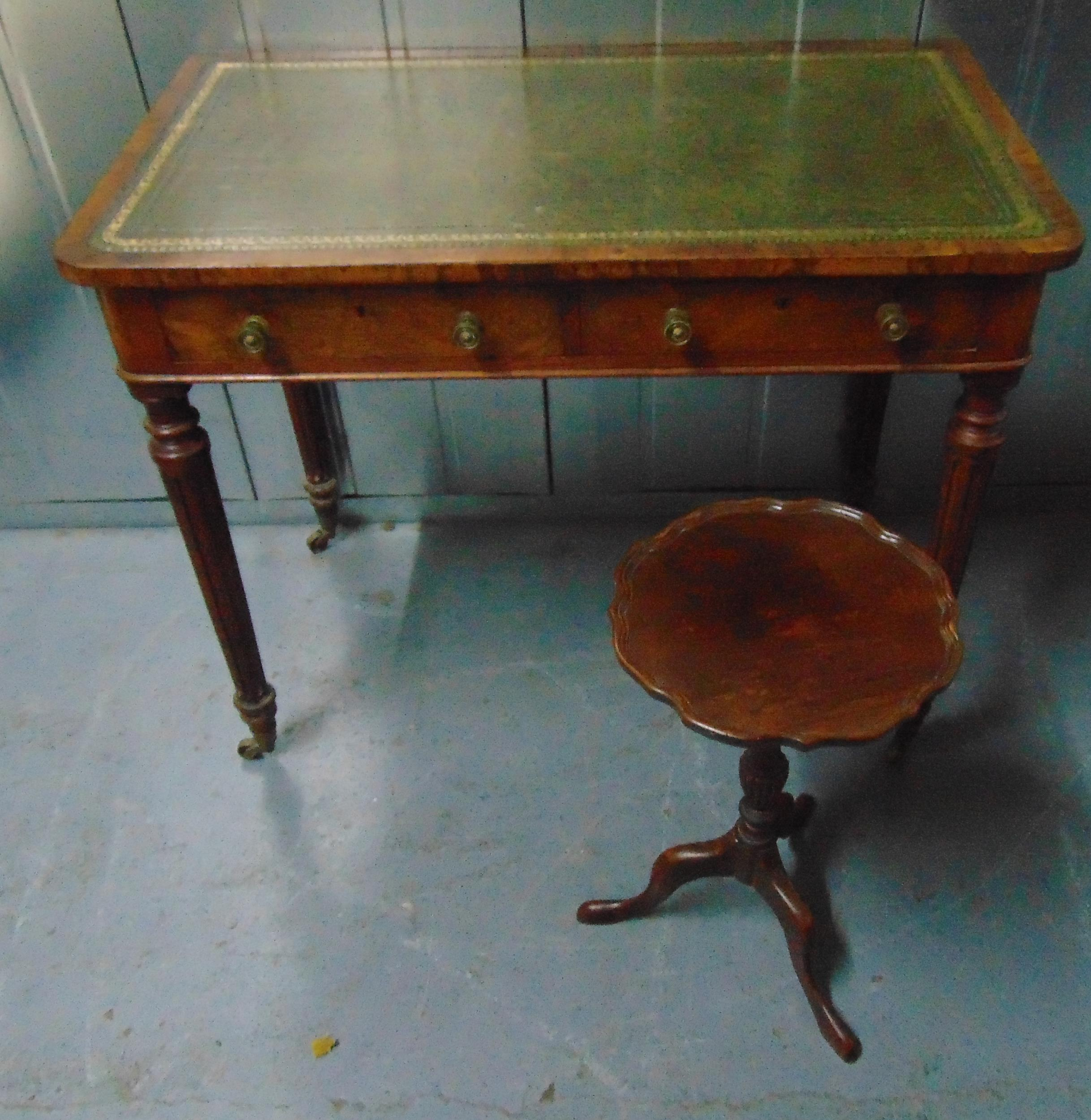 An Edwardian rectangular hall table with tooled leather top, two drawers on four fluted tapering