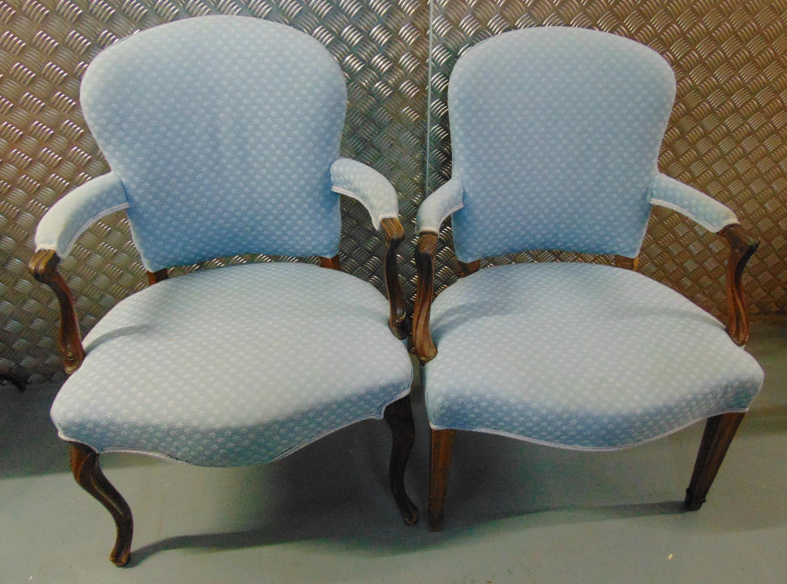 Two upholstered mahogany armchairs