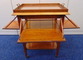 A rectangular French mahogany tea tray table with satinwood inlaid bands and hinged sides, on four