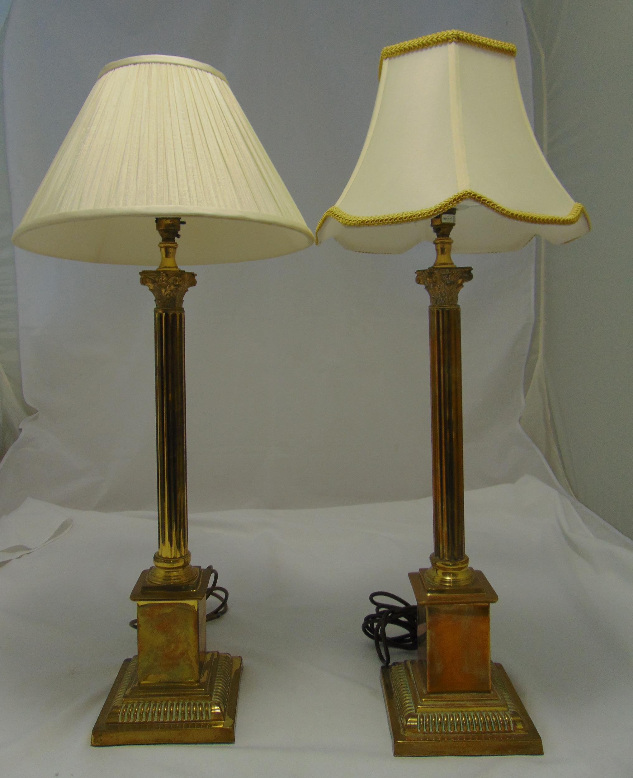 A pair of brass Corinthian column table lamps on stepped square bases, to include shades, 82cm (h)