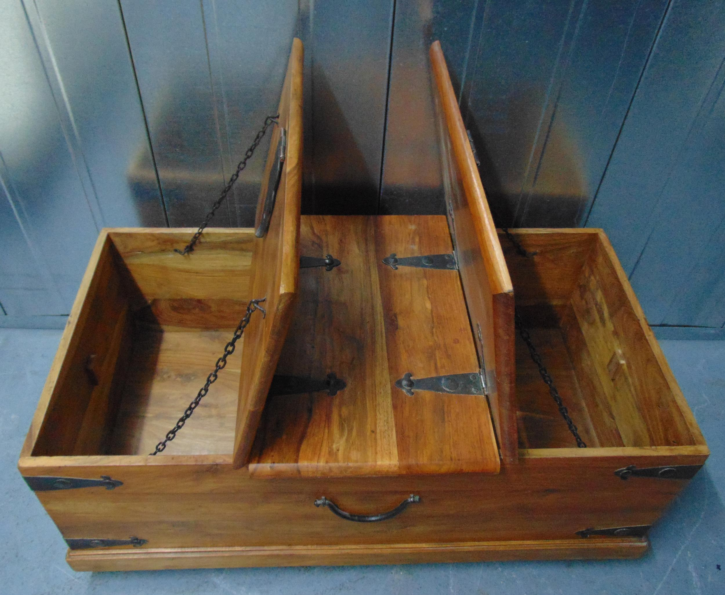 A rectangular wooden chest with metal bands to the sides and hinged top, 46 x 110.5 x 60cm - Image 2 of 2