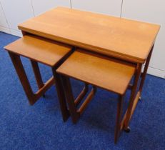 A rectangular teak tea table with revolving folding top and two matching side tables by Macintosh of