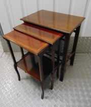 A nest of four mahogany tables with satinwood banding on tapering rectangular legs, 69 x 55 x 37.cm