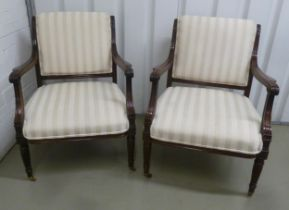 A pair of early 20th century mahogany occasional chairs with upholstered seats and backs on turned
