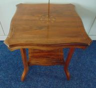 An Edwardian mahogany square side table with satinwood inlays on four angled rectangular legs, 52