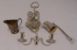 A hallmarked silver condiment set, the trefoil stand with pierced central scroll handle on leaf feet