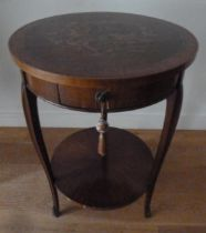 An early 20th century mahogany circular two tier occasional table, with single drawer, the top