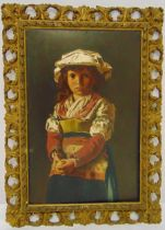 A continental framed oil on panel of a young girl wearing traditional dress and holding an apple, 46