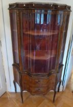 A French style serpentine fronted glazed display cabinet, the hinged door revealing two shelves