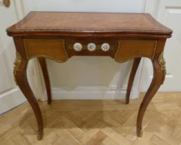 A French style inlaid rectangular games table with applied porcelain roundels and gilded metal